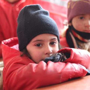 On 29 January 2017 in the Syrian Arab Republic, Shaimaa, 6, attends her first day of Grade 1 at the Kheir eddine Al-Asadi School in the Sakhoor neighbourhood of eastern Aleppo. The third floor of the school building sustained heavy damage during the fighting and remains unusable. Approximately 600 children are squeezed into classrooms on the remaining two floors. UNICEF and its partners are conducting rapid assessment of school conditions in East Aleppo. Of the 422 schools, 217 are either destroyed, damaged or inaccessible.